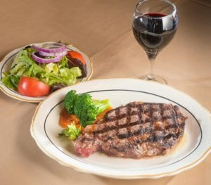 Steak dinner with salad and wine at Fireside Chophouse in WIlliamsburg, VA